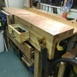"Made from rough sawn pine, hand planed and adapted to suit workspace 60""x29"" with dovetailed draws for storage."