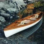 This is a 14 foot canoe made from okoume marine plywood and mahogany. It is a modified reproduction of a design by Henry Rushton - a canoe builder who lived in Canton, New York in the late 1880's. He was America's premier builder of double-paddle canoes which were very popular at the time. These canoes are usually propelled using a kayak paddle, but they can also be sailed. Mr. Rushton was known for his extremely lightweight and durable canoes some of which weighed about 10 pounds. My canoe weighs only 50 pounds and could be built even lighter if spruce were substituted for the mahogany.