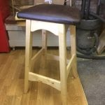 Made this out of scrap pine and faux leather left over from another project so I could sit at the bench when drawing plans. Finished in blond shellac.