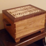 Walnut and (either cherry or birch, other?, not sure) with basswood kumiko pattern inset on top.