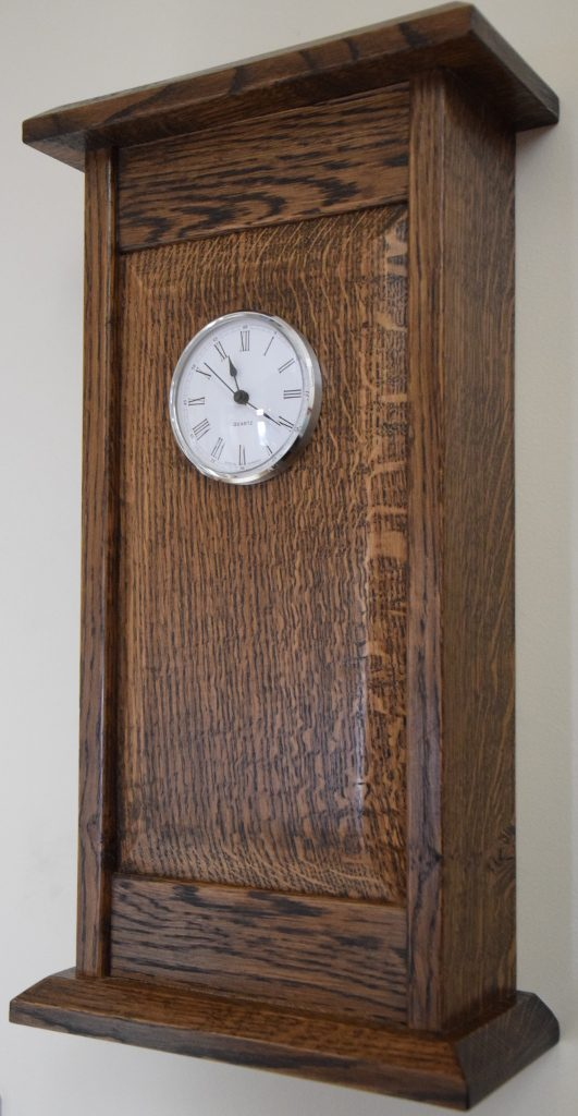 Oak Wall Clock. Number 5 of 5 now produced, this in American WHite Oak for the frame and English Oak for the panel. Stained in Georgian Dark Oak and finished with Pale Shellac and polished with Beeswax and Turpentine