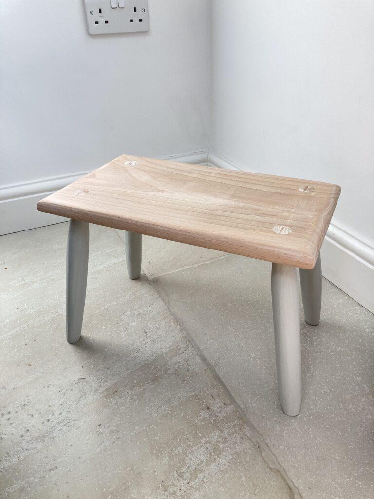 Footstool by Nina S